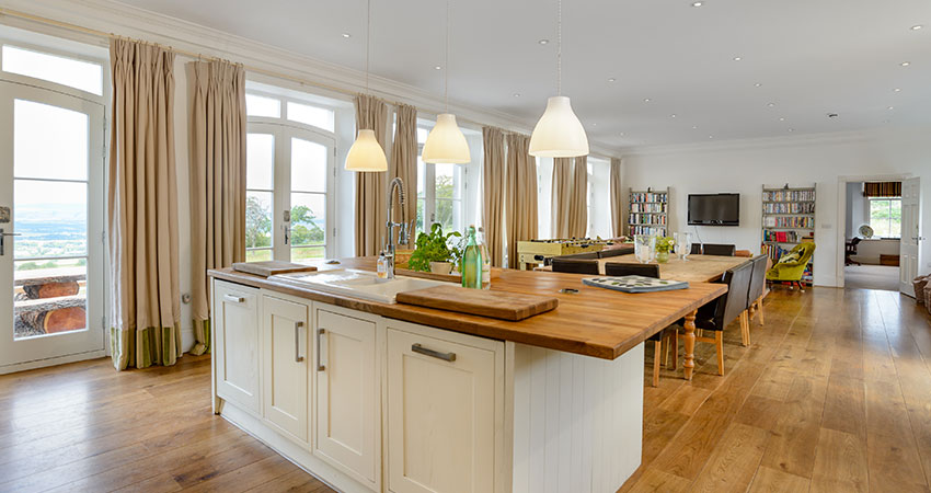 An open kitchen and dining suite with a view - overlooking Gleneagles and the Perthshire Hills