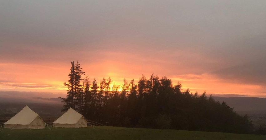 Stunning sunsets light up the lawn suitable for Bell tents, extra accommodation for weddings and celebrations
